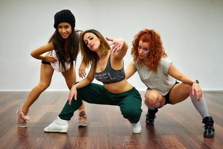 Hip hop girls posing in dancing school. photo