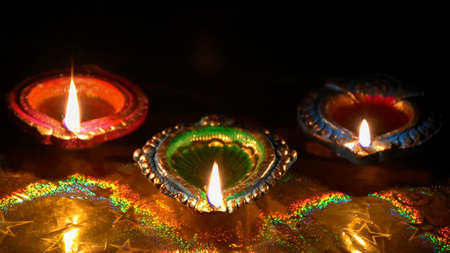 Diwali celebration - Diya lamps with glitter light background