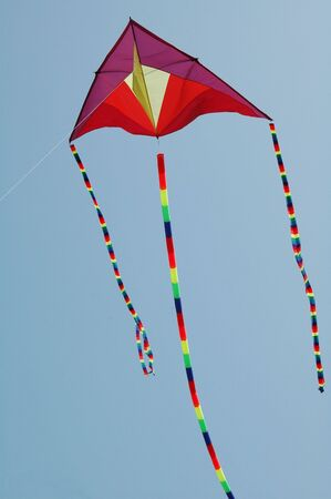 Colorful Kite Flying in the Blue Summer Sky
