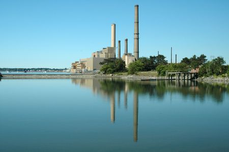 Salem Harbor Power Plant reflected in a quiet cove off Salem, MA