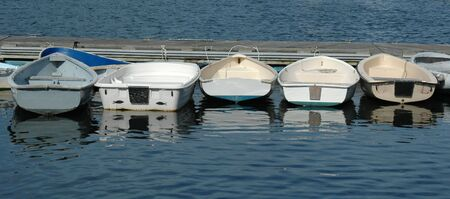 dinghies: Dinghies lined up at dock Stock Photo