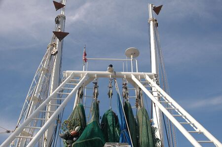 shrimp boat: View of the rigging of a shrimp boat