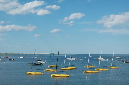 Boats in the Essex River, Essex, MA, on a clear summer day Imagens