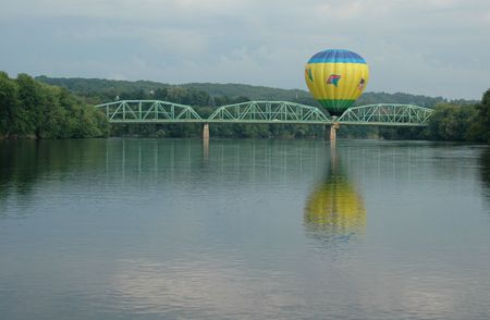 Hot air balloon floating over the Androscoggin River in Lewiston, Maine