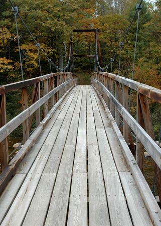 Cable suspended footbridge in Western Maine on a fall day