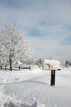 frigid: Snow covered mailbox against a cold New England winter landscape