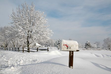 countryside landscape: Snow covered mailbox against a cold New England landscape Stock Photo