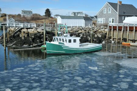 Fishing boat docked in an ice filled harbor at Biddeford Pool, Maine