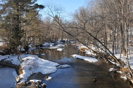 A very cold looking river on a winter day in Andover, Maine photo