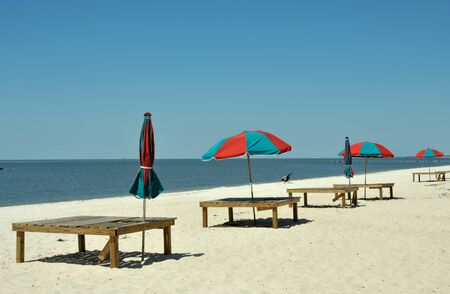 Colorful umbrellas and lounge chairs on Biloxi Beach, Mississippi Banco de Imagens
