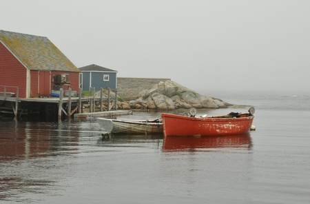 cove: Picturesque village of Peggys Cove, Nova Scotia, on a foggy summer day Stock Photo