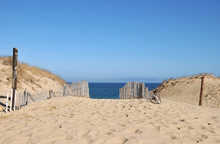 Old wooden fences and sand dunes at Race Beach on Cape Cod