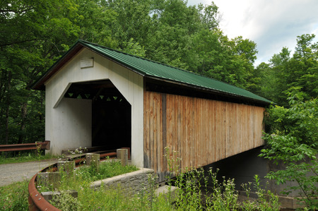 montgomery: Hutchins covered bridge in Montgomery, VT, on an overcast summer day Stock Photo