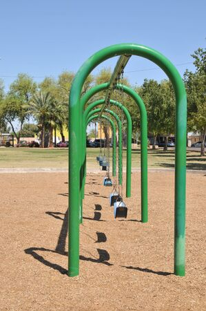 swing set: Perspective shot of a swing set at a park in Avondale, AZ