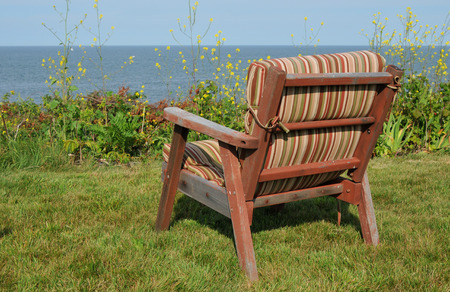 comfy: Comfy looking chair overlooking the waters off Bakers Island off the coast of Beverly, Massachusetts Stock Photo