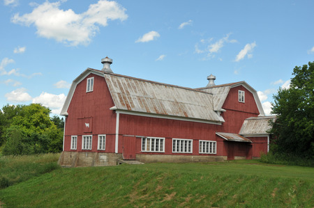 farm structures: Very large red barn on a farm near Stowe, Vermont