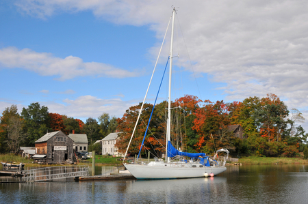 White sailboat moored in the Essex River at high tide