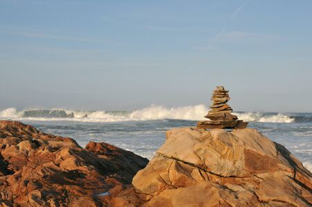 Rock pile at Bass Rocks in Gloucester, Massachusetts, with surf from Hurricane Humberto in the background