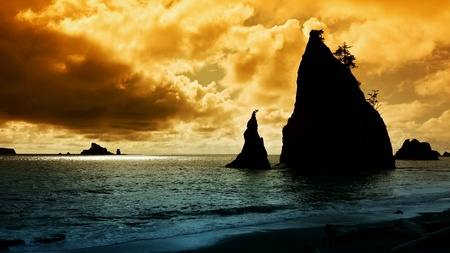A shot of a Washington State coast sunset with rock formation in the foreground
