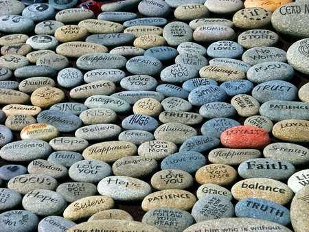 A shot of some stones engraved with words and phrases.