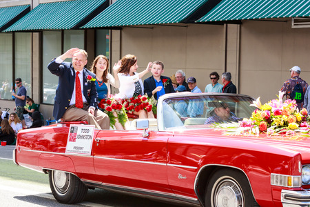 Portland, Oregon, USA - JUNE 7, 2014  Rose Festival President, Todd Johnston in Grand floral parade through Portland downtown  Editorial