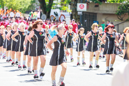 live again: Portland, Oregon, USA - JUNE 7, 2014 , One More Time Around Again Marching Band in Grand floral parade through Portland downtown  Editorial