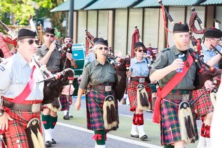 clan: Portland, Oregon, USA - JUNE 7, 2014  Clan Macleay Pipe Band in Grand floral parade through Portland downtown