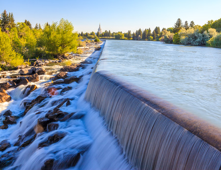 Idaho Falls, Idaho - JULY 1, 2012: The small waterfall on Snake River is a part of Power HydroElectric project in Idaho Falls.