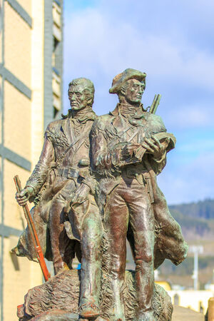 deemed: Seaside, Oregon - APRIL 14, 2012: Bronze statue of Meriwether Lewis and William Clark is deemed as the official end of the Lewis and Clark Trail.