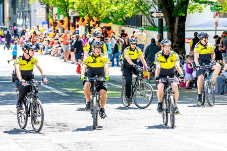 bureau: Portland, Oregon, USA - JUNE 7, 2014: Portland Police Bureau in Grand floral parade through Portland downtown.