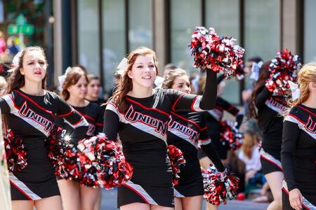 portland: Portland, Oregon, USA - JUNE 7, 2014: Union High School Marching Band in Grand floral parade through Portland downtown.