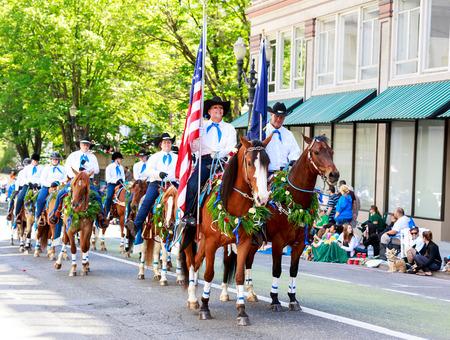 portland: Portland, Oregon, USA - JUNE 7, 2014: Pacific Wild Horse Club in Grand floral parade through Portland downtown.