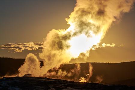 faithful: Sunset of Old Faithful in Yellowstone National Park