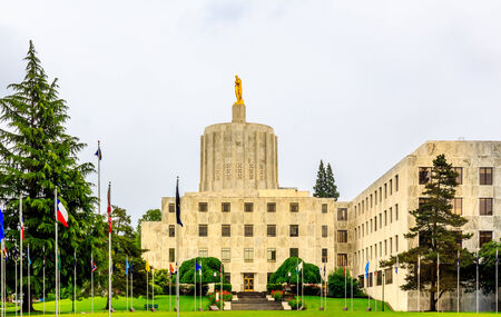 famous industries: Salem, Oregon, United States - May 22, 2013: The Oregon Capitol Building shows the pioneer statue atop the capitol. Stock Photo