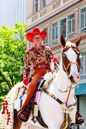 constantino: Portland, Oregon, USA - JUNE 7, 2014: Maggy Constantino in Grand floral parade through Portland downtown. Editorial