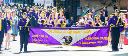 portland: Portland, Oregon, USA - JUNE 7, 2014: Columbia River High School Marching Band in Grand floral parade through Portland downtown.