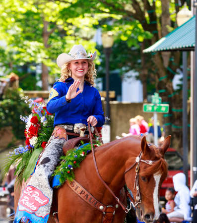 portland: Portland, Oregon, USA - JUNE 7, 2014: St. Paul Rodeo Court in Grand floral parade through Portland downtown. Editorial