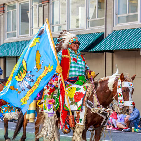 portland: Portland, Oregon, USA - JUNE 7, 2014: The Confederated Tribes of Warm Springs in Grand floral parade through Portland downtown.