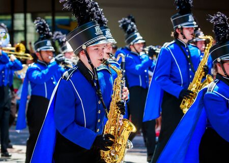 marching band: Portland, Oregon, USA - June 6, 2015: Hillsboro High School Marching Band in the Grand Floral Parade during Portland Rose Festival 2015.