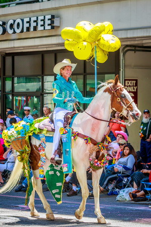 Portland, Oregon, USA - June 6, 2015: Maggy Constantino and Cloud in the Grand Floral Parade during Portland Rose Festival 2015.