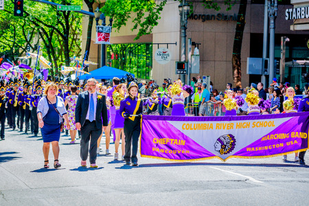 marching band: Portland, Oregon, USA - June 6, 2015: Columbia River High School Marching Band in the Grand Floral Parade during Portland Rose Festival 2015. Editorial