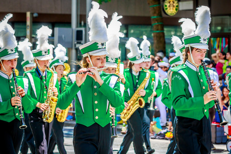 wilson: Portland, Oregon, USA - June 6, 2015: Wilson High School Marching Band in the Grand Floral Parade during Portland Rose Festival 2015.