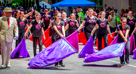 marching band: Portland, Oregon, USA - June 6, 2015: Sunset High School Marching Band in the Grand Floral Parade during Portland Rose Festival 2015.