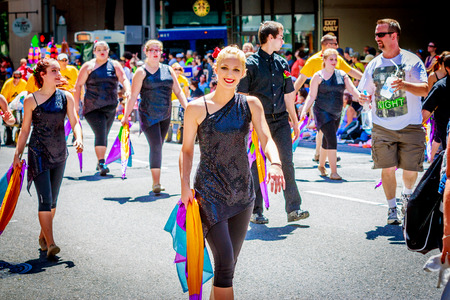 marching: Portland, Oregon, USA - June 6, 2015: Evergreen High School Marching Band in the Grand Floral Parade during Portland Rose Festival 2015. Editorial