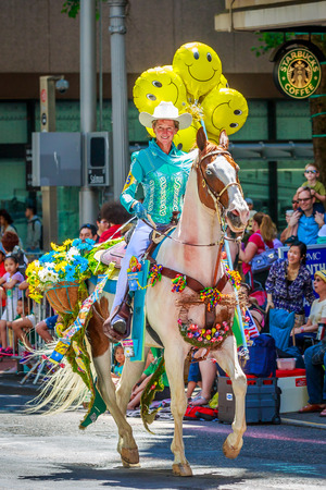 constantino: Portland, Oregon, USA - June 6, 2015: Maggy Constantino and Cloud in the Grand Floral Parade during Portland Rose Festival 2015.