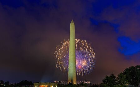 washington monument: Washington DC, USA - July 04, 2015: Washington Monument stands tall with Fourth of July Fireworks in background.