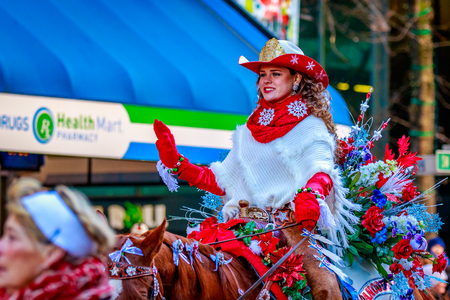 macys: Portland, Oregon, USA - November 27, 2015: Miss Vancouver Rodeo Queen, Felicia Harrison, in the annual My Macys holiday Parade across Portland Downtown. Editorial