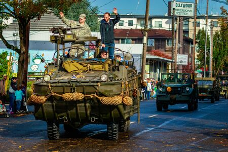 veterans day: Portland, Oregon, USA - November 11, 2015: People march in the annual Ross Hollywood Chapel Veterans Day Parade, in northeast Portland.