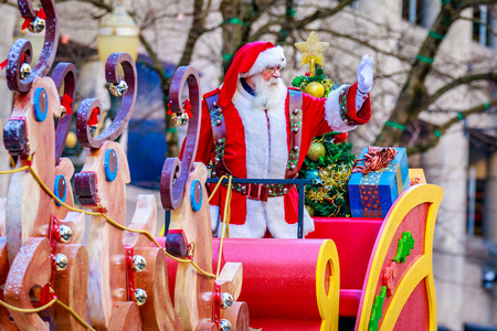 macys: Portland, Oregon, USA - November 27, 2015: Costumed Santa Claus on Sledge march in the annual My Macys holiday Parade across Portland Downtown. Editorial