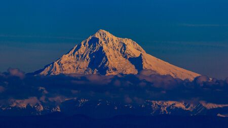 mt  hood: Mt Hood at sunset time, with peak above layer of cloud. Stock Photo